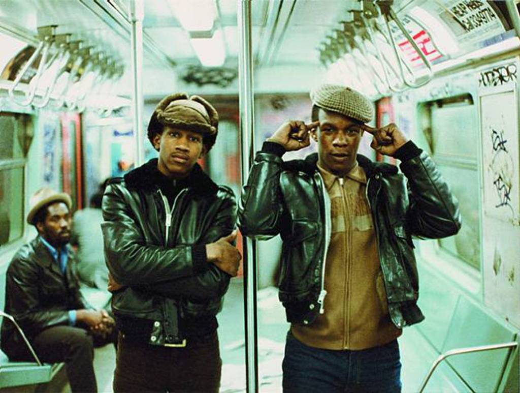 Two men on the subway by Jamel Shabazz