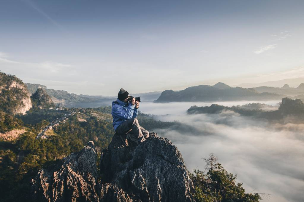 Photographer on mountain