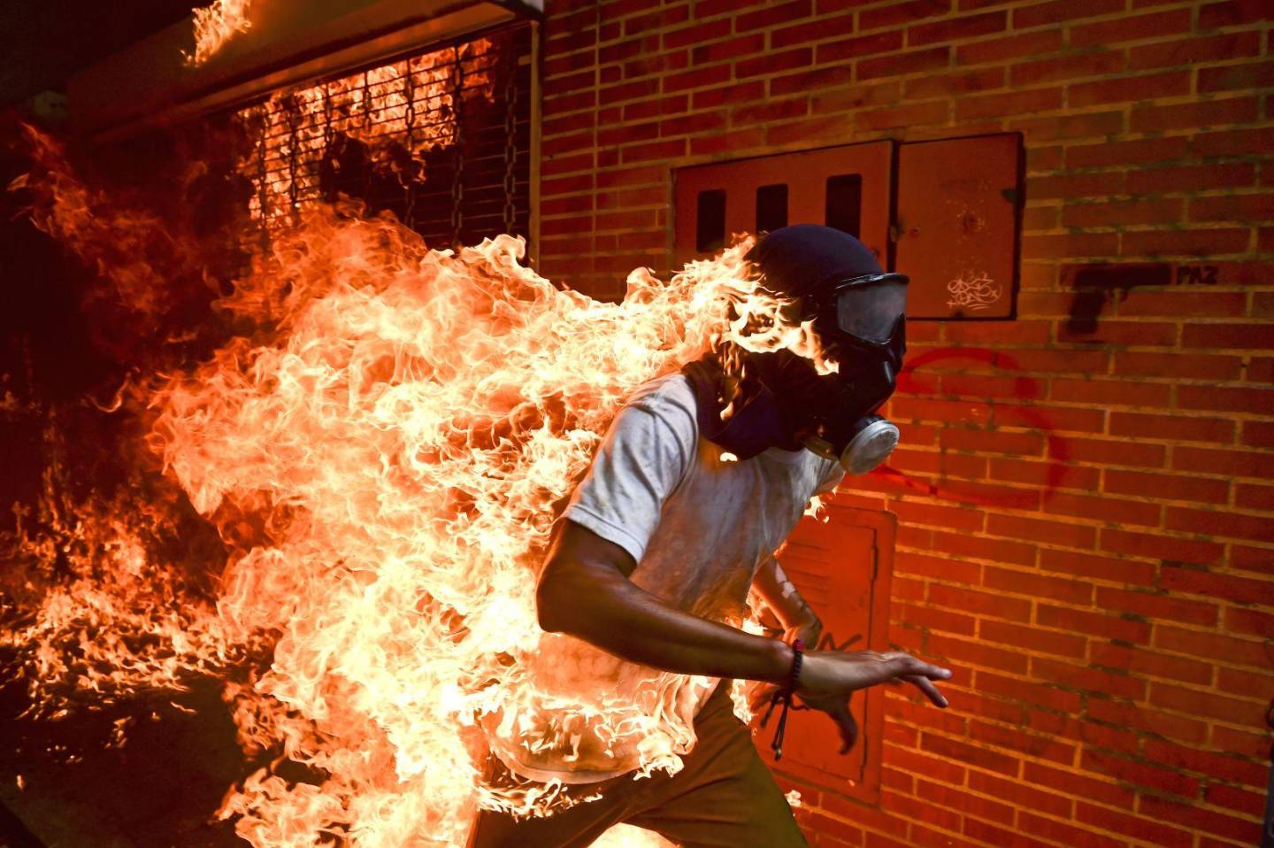 Man on fire protesting President Madura in Venezuela