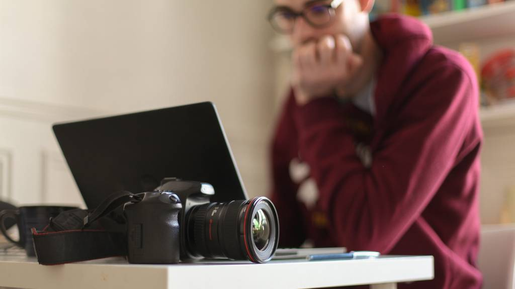 A photographer editing his work