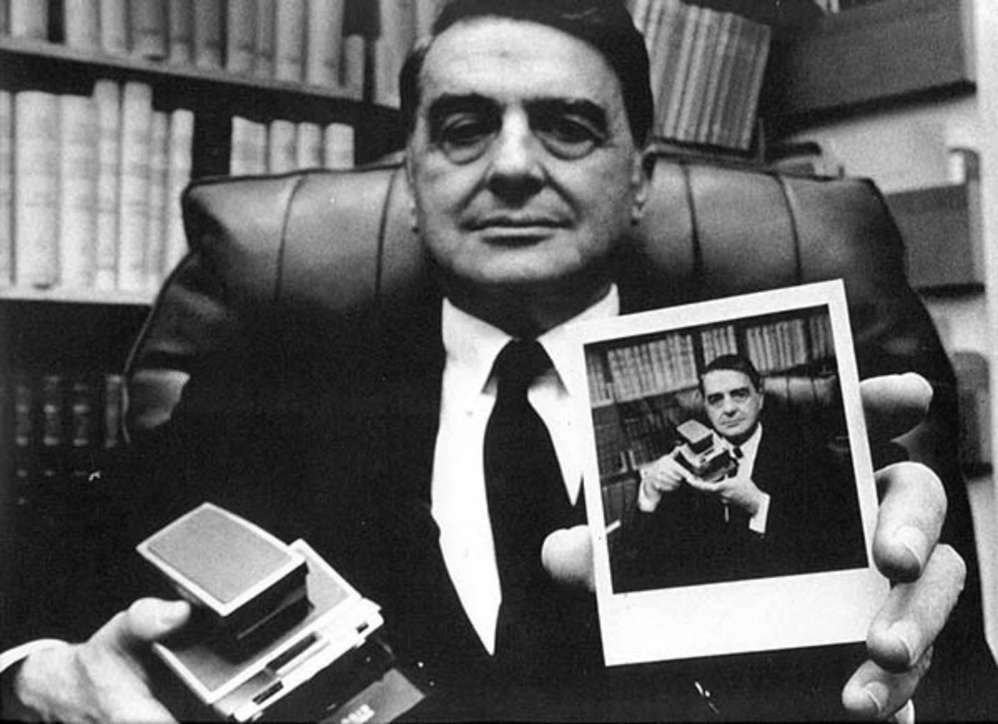 Inventor of the original Polaroid, Edwin Land holds the very first instant film camera